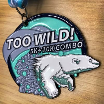 A photograph of the Too Wild! Race finisher medal